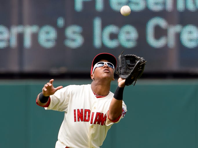 Jose Ramirez of the Cleveland Indians catches a fly ball hit by Nelson Cruz of the Baltimore Orioles during the sixth inning at Progressive Field on August 17 in Cleveland.