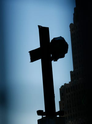 The steel remnant in the shape of a cross is left as a memorial on the site of the World Trade in New York.