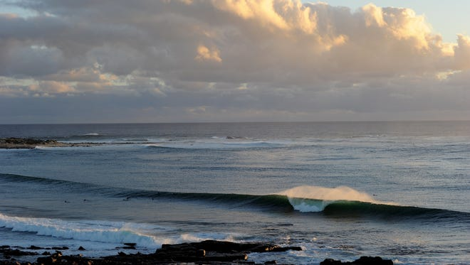 Surfers at Cowaramup Bay, close to Lefthanders Beach, where a young man was killed in a suspected shark attack in the south-west region of Western Australia.