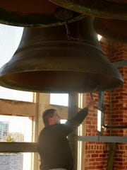 Pastor John White talks about ringing the largest bell in the tower at First Presbyterian Church in Jackson before ringing it 26 times on Friday morning for 26 people who were killed at Sandy Hook Elementary in Connecticut in this 2012 file photo.