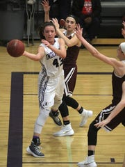 Indianola sophomore Grace Berg throws a baseline pass against Ankeny. Class 5-A fifth-ranked Indianola beat Ankeny 52-47 in Indianola on Dec. 15.