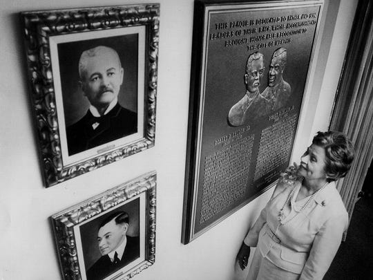 Roberta Church looks at paintings and plaques honoring her grandfather, Robert Church Sr. (top) and father,  Robert Church Jr. (bottom) on June 3, 1976. Robert R. Church Sr., the South's first African-American millionaire, founded Church Park in 1899. Robert Church Jr. spearheaded the founding of the Memphis NAACP in 1917 and the Lincoln Republican League in 1916.