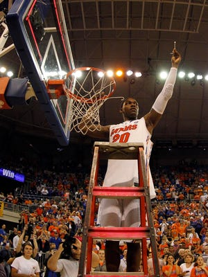 Florida's Michael Frazier II cuts down the nets after the Gators beat Kentucky on Saturday.