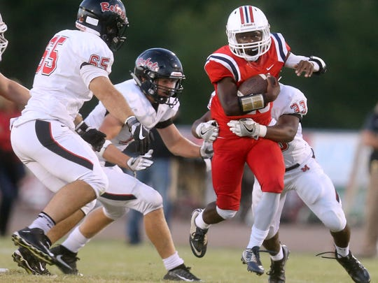 Oakland's quarterback Timmy Goodrich (10) runs the ball as Maryville's Tyler Brooks (65), Spencer Shore (11) and Michael Buchanan (33) all move in for a tackle during a game against