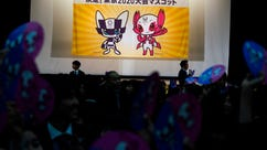 """FILE - In this Feb. 28, 2018, file photo, the characters which will serve as mascot for the Tokyo 2020 Olympic and Paralympic Games, are unveiled, in Tokyo. John Coates, the head of the International Olympic Committee inspection team visiting Tokyo as it prepares for the 2020 Olympics, warned local organizers on Monday, April 23, 2018 to get ready for some complaints. Coates says organizers are entering a """"phase where questions from stakeholders become very pragmatic and very urgent."""" The sign reads: """" Decision! Mascots for the Tokyo 2020 Games."""" (AP Photo/Eugene Hoshiko, File)"""