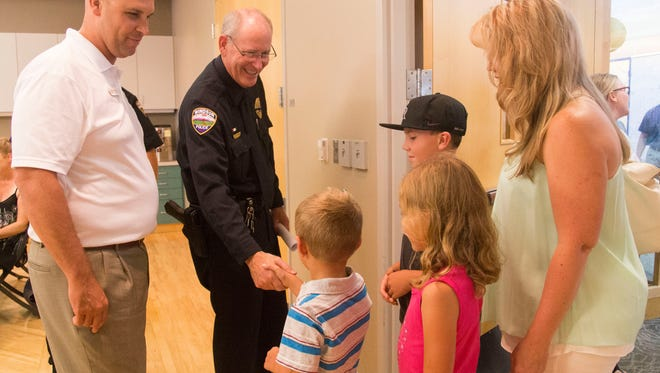 The Rennemeyer family congratulates Windsor Police Chief John Michaels on his retirements Thursday, July 21, 2016. Michaels was chief for 32 years and served for a combined 40 years for the Windsor Police Department.
