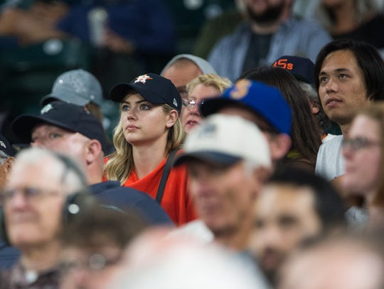 Model Kate Upton, in red, the fiancee of Justin Verlander