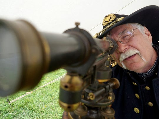 Robert Mergel of Reynoldsburg, Ohio demonstrates how a wye level, used for engineering, was useful during the Civil War era Saturday at the Richland County Fairgrounds.