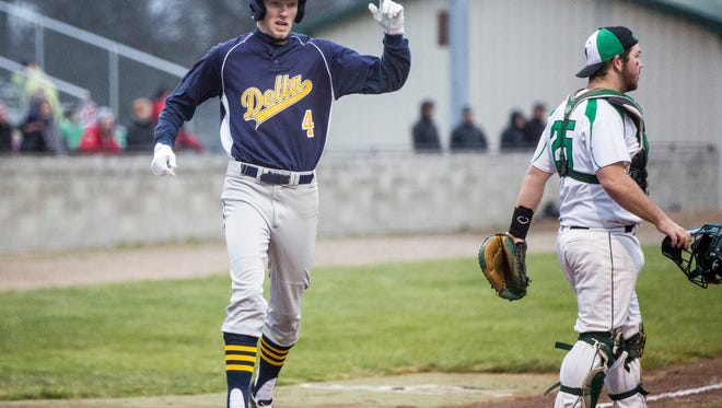 Delta's Mitchell Hahn crossed home plate against Yorktown on April 4. Delta will face Bellmont in the Class 3A Bellmont Regional Saturday at 11 a.m.