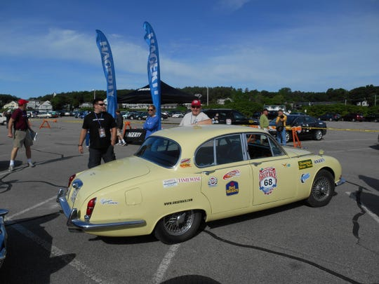 "Tom Nawojczyk standing next to his 1966 Jaguar during last year's ""Hemmings Motor News"" Great Race from Maine to Florida. This year's race runs from Missouri to the Santa Monica Pier, passing through cities like San Bernardino and Twentynine Palms."