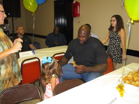Shaquille O'Neal greets children at City Marshal Brian Pope's event
