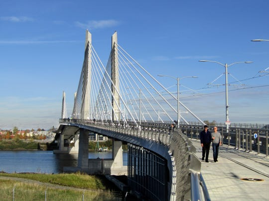 Pedestrians cross Tilikum Crossing. Portland's new bridge does not allow private automobiles.
