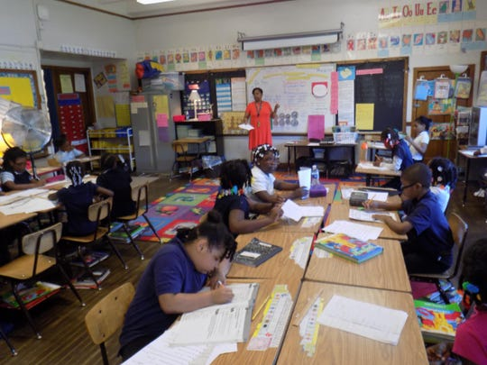 Mitzi Davis teaches her class of second-grade students at Thirkell Elementary-Middle School in Detroit.