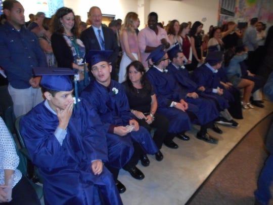 Anderson Center for Autism graduates prepare to receive their diplomas.