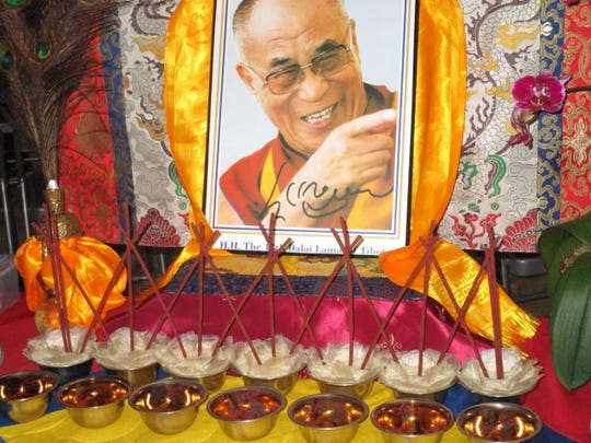 A picture of the Dalai Lama on display at ESA campus in Lafayette.