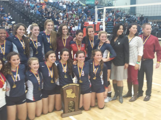 The Teurlings volleyball team celebrates its second straight state title at the Ponchitrain Center in Kenner.