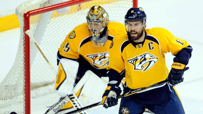 Nashville Predators defenseman Shea Weber (6) and goalie Pekka Rinne (35) during the first period against the Dallas Stars at Bridgestone Arena.