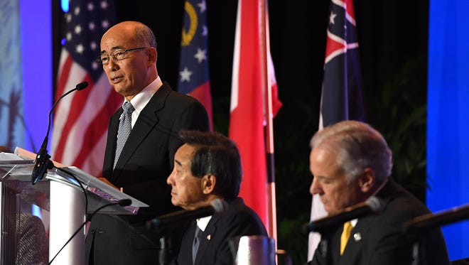 His Excellency Kenichiro Sasae, Ambassador of Japan to the United States speaks during the 40th Annual Joint Meeting of the Southeast U.S.-Japan & Japan-U.S. Southeast Associations in downtown Greenville on Monday, October 23, 2017. Also pictured are Japan-United States Southeast Association Chairman, Teruo Asada, center, and South Carolina Governor Henry McMaster.
