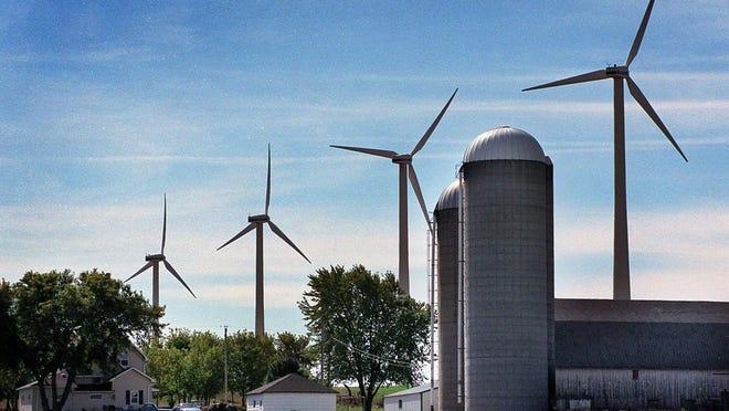 Wind turbines hover near a farm outside of Algoma.