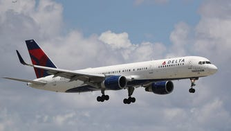 A Delta Air Lines plane is seen as it comes in for a landing at the Fort Lauderdale-Hollywood International Airport on July 14, 2016 in Fort Lauderdale, Fla.
