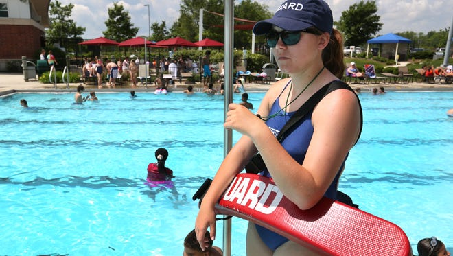 Lifeguard Natalie Brooks, Fishers, keeps an eye on children swimming in the activity pool in the Waterpark at Carmel Clay Parks and Recreation's Monon Community Center on Friday, May 29, 2015. With the summer months ahead, everyone enjoying the water should observe water safety. Two persons have died in drowning incidents in the past week, one in an apartment complex pool and the other at Morse Reservoir.