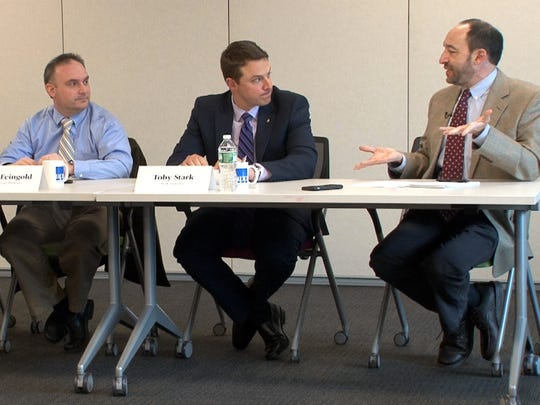 Asbury Park Press business reporter Michael Diamond (right) moderates the Asbury Park Press Business Roundtable on health care affordability in Neptune.