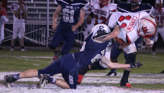 Silver's defense stepped up Friday night against Hatch Valley. Above, Trey Jameson tallies a sack in the second quarter of the game on Shane Carson Casey.