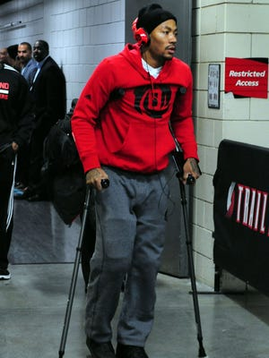 Chicago Bulls point guard Derrick Rose walks out of the Moda Center on crutches after being injured in the game against the Portland Trail Blazers Saturday night.