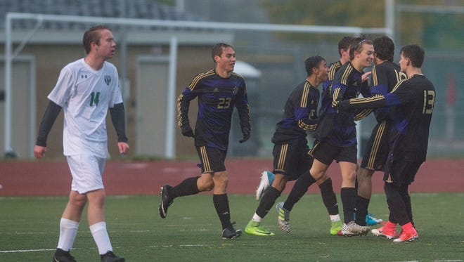 Fort Collins High School celebrates a goal during a game against Fossil Ridge on Monday, October 2, 2017.