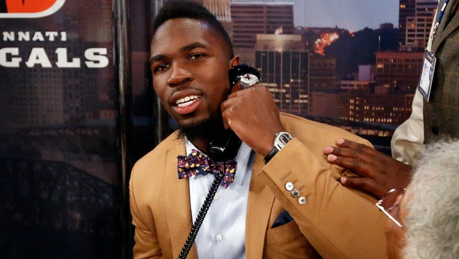 C.J. Mosley takes a call before being selected 17th overall by the Baltimore Ravens in the first round of the NFL draft Thursday.