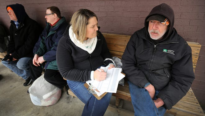 Wednesday, Jan. 27, 2016: Brandy Medaugh, a client care specialist at the Diocese of Covington's Catholic Charities, talks to Kenneth Ravenscraft outside of the Parish Kitchen in Covington. Ravenscraft says he has been homeless for six years. They were part of a 24-hour homeless count.