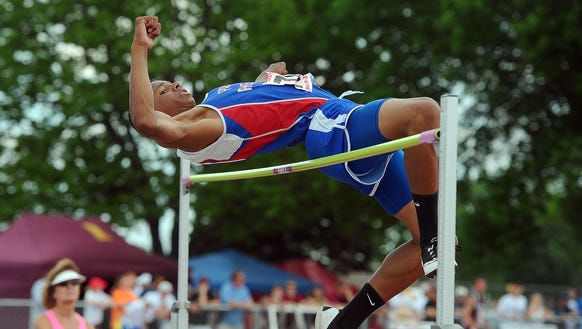 Parker's Zack Anderson competes in the high jump at