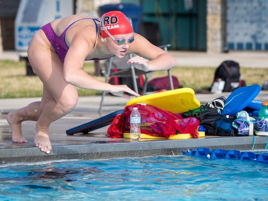 Emily Weiss runs drills at Tuhey Pool Thursday morning