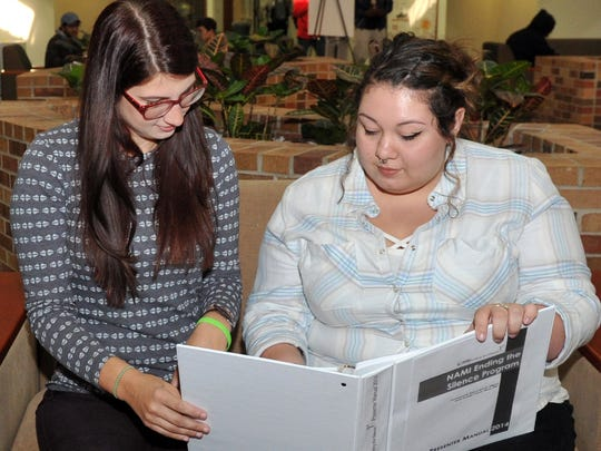 In this file photo, Kerrigan Reyes, a volunteer with National Alliance on Mental Illness Wichita Falls, right, and Executive Director Jessica Cartwright review notes before a presentation at Midwestern State University. NAMI announced it will be closing its doors after 28 years in the Wichita Falls area.