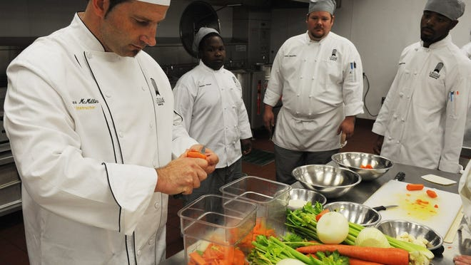 In 2009, Chef Spencer McMillin demonstrated his technique to tourne veggies for students at the grand opening at the L'Ecole Culinaire Memphis.
