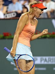 Maria Sharapova pumps her fist after gaining advantage and a chance at match point against Victoria Azarenka on Monday, March 16, 2015 during the BNP Paribas Open in Indian Wells, Calif. Sharapova won in straight sets 6-4, 6-3.