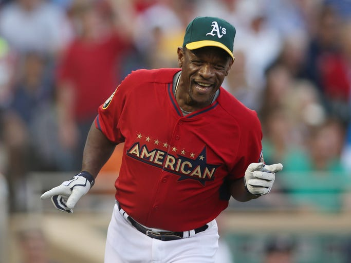 Rickie Henderson reacts after hitting a home run.
