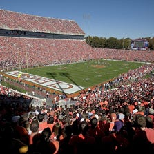 """CLEMSON, SC - NOVEMBER 12:  Fans fill """"Death Valley"""" to watch a game between the Clemson Tigers and the Florida State Seminoles on November 12, 2005 at Clemson Memorial Stadium in Clemson, South Carolina.  (Photo by Grant Halverson/Getty Images)"""