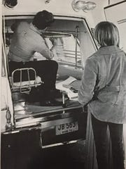 Bo Keck hangs a stretcher in the back of a Byrd model ambulance/hearse, which was commonly used for transporting patients in the 1960s and 1970s.