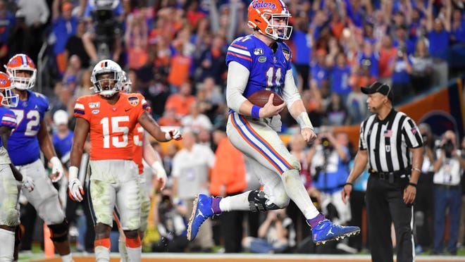 Florida quarterback Kyle Trask (11) reacts after scoring a touchdown against Virginia during the Orange Bowl on Dec. 30 at Hard Rock Stadium in Miami Gardens, Fla.