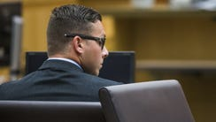 Former Mesa police Officer Philip Brailsford sits in