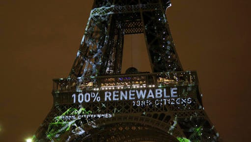 FILE- In this Sunday, Nov. 29, 2015 file photo, an artwork entitled 'One Heart One Tree' by artist Naziha Mestaoui is displayed on the Eiffel tower ahead of the 2015 Paris Climate Conference, in Paris.  The Paris Agreement on climate change comes into force Friday Nov. 4, 2016, after a year with remarkable success in international efforts to slash man-made emissions of carbon dioxide and other global warming gases.