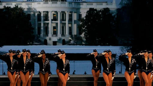 FILE - In this Wednesday, Jan. 19, 2005, file photo, the Rockettes perform during the Celebration of Freedom Concert on the Ellipse, with the White House in the background in Washington. The Radio City Rockettes have been assigned to dance at President-elect Donald Trump's inauguration January 2017.