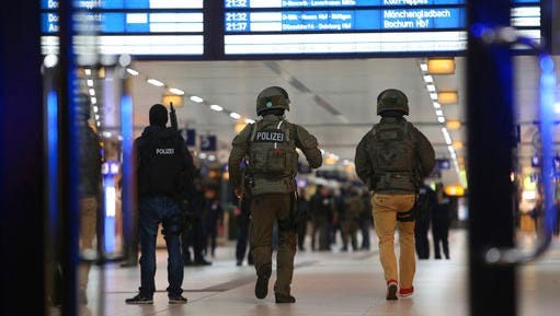 Special police forces walk in the main train station in Duesseldorf, western Germany, Thursday, March 9, 2017 after several people have been injured in an attack with an ax.