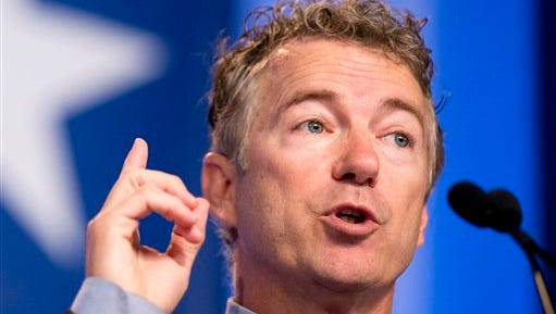 FILE - In this Sept. 26, 2014 file photo, Sen. Rand Paul, R-Ky. speaks in Washington. Two prominent Senate Republicans announced Tuesday they would seek a second term in the Senate, although their announcements had dramatically different implications for the 2016 presidential contest. Paul announced he would also seek a second term in the Senate, although his team says he could still run for president despite a state law that prohibits running for both offices at the same time.  (AP Photo/Manuel Balce Ceneta, File)