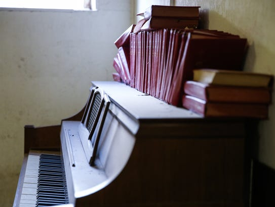 An old piano is left behind at the Greater St. Paul