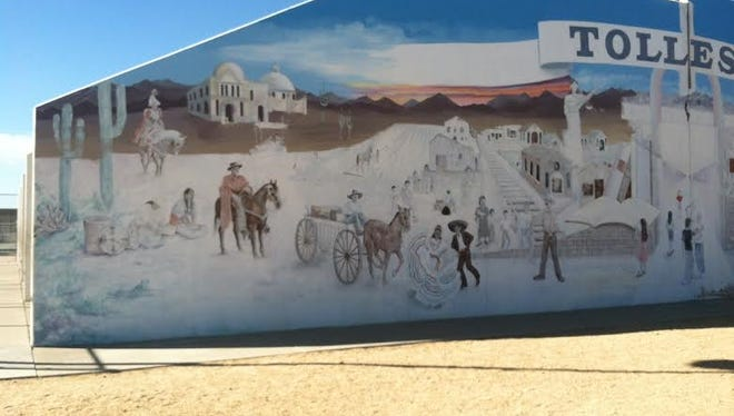 Bonnie Mostert Lewis is refreshing a mural she created in Tolleson in 1994.