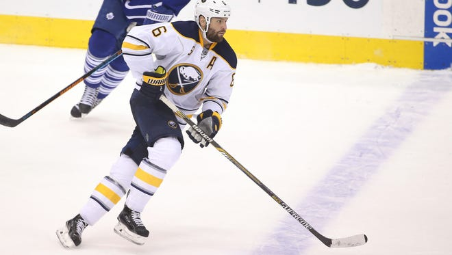 Sabres defenseman Mike Weber (6) skates out with the puck against the Toronto Maple Leafs last season.