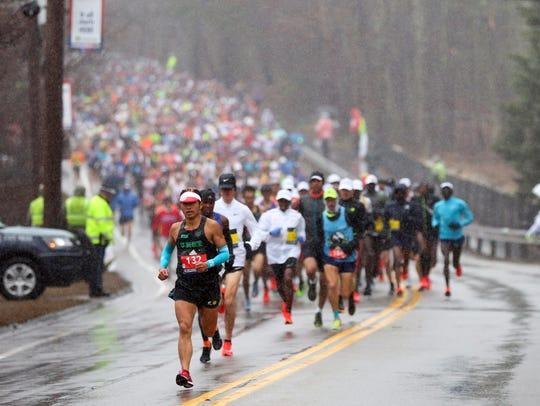 Runners race on the 2018 Boston Marathon course.