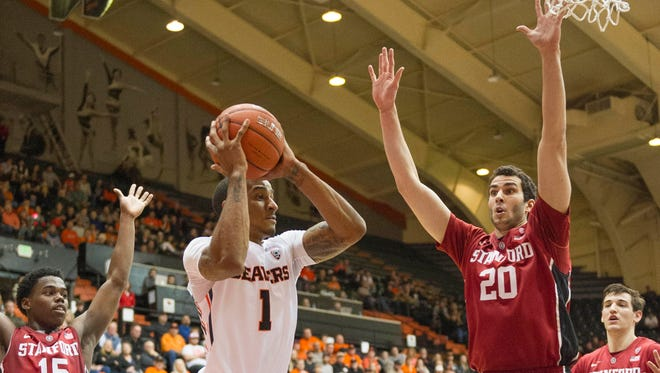 Oregon State guard Gary Payton II (1) shoots while being defended by Stanford center Josh Sharma (20) and guard Marcus Allen (15) in the Beavers' 78-72 loss on at Gill Coliseum on Jan. 6, 2016.